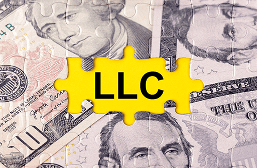 LLC cost being shown by an American money puzzle with a missing piece titled LLC