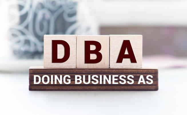 DBA in wooden block letters