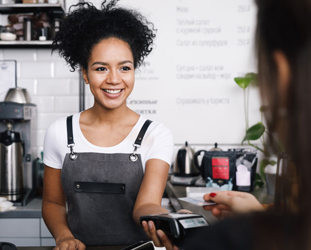 business owner taking payment